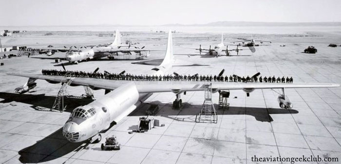 B-36 crews standing on top of the Peacemaker wing